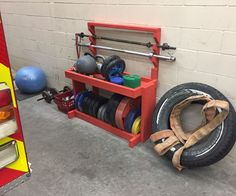 I got tired of stuff laying all over the place so I decided to make a rack for all of it. Its very sturdy, I weigh almost 200lbs and can sit on the top tray without any movement. The way the bottom trough is setup it should hold as much weight as you can fit in there. The silver bar in that picture is not an olympic size bar, its a little stubby thing. The distance between sleeves on my olympic bar is more than wide enough to fit on there and sit pretty. I used almost an entire 1# box of…