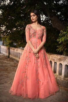 You can have anything in life if you dress for it.Issa peach coloured evening gown with floral hand embroidery.They can customize the dress as per your requirement. For more detail 13 June 2018 Indian Wedding Gowns, Indian Gowns Dresses, Indian Fashion Dresses, Indian Outfits, Floryday Dresses, Heavy Dresses, Pink Gowns, Indian Clothes, Blue Dresses