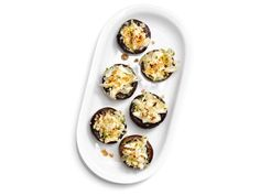 Surf 'n' Earth Stuffed Mushrooms : Pack mushrooms (which are from the earth) with lump crab meat (from the surf) for a savory, bite-size appetizer with a punny name.