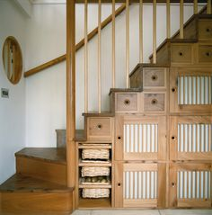 Johnny Grey Studios. This would make a great pantry if the staircase was in the kitchen