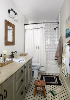 with leaving the original floors this would be nice - just grout the subway tile darker to match.....