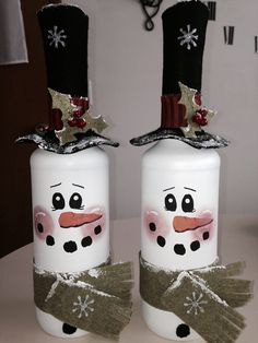 Spray painted wine bottles with painted faces and felt accessories! (Hat comes off to add lights inside bottle)