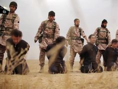 An image grab taken from a propaganda video released on Sunday by al-Furqan Media allegedly shows members of the Islamic State jihadist group preparing the simultaneous beheadings of at least 15 men described as Syrian military personnel.