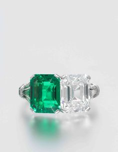 An Important Platinum, Emerald and Diamond Ring, containing one octagonal step…