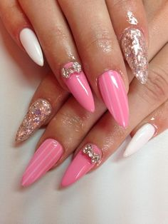 Pink almond tip nails with glitter bows! I'm trying these this summer for sure,they are gorg.