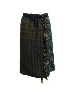 As Know As de Base flower skirt  Coloured skirt with removable underskirt, it's possible to wear in many way with the prefer part always stand out    Composition: 100% wool Underskirt: 50% acrylic 50% polyester