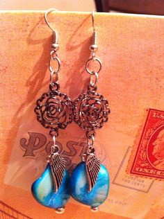 Check out this item in my Etsy shop https://www.etsy.com/listing/163968172/feather-rose-earrings