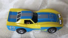 AURORA AFX LIGHTED BODY CORVETTE #12 YELLOW BLUE CHASSIS LIGHTED