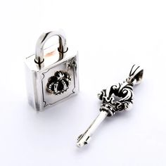 Our Sterling Silver Lock and Key Pendant consists of a padlock and a key to unlock it. You can rock both pieces simultaneously or give the key to someone you love Skull Pendant, Key Pendant, Sterling Silver Cross, Sterling Silver Pendants, Biker Accessories, Silver Man, Jewelry Collection, Mens Jewellery, Biker Rings