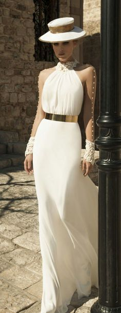 White chiffon maxi dress with jeweled neckline and lace cuffs topped with tre chic barely-there sleeves!
