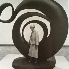 Georgia O'Keeffe poses in front of her piece Abstraction