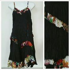 "Playful Urban dress NWT Urban chic black crinkled dress with floral ruffles plus thread and button details.   Adjustable straps Length is approx 42"" but will vary depending on were you adjust the straps  Material 100% cotton Dresses Midi"