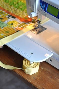 Quilt Binding Trick - When your machine sits on top of a table, this is a great idea using what's already under your nose.