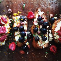 """Berry Ricotta #Toast with roasted blueberries, orange zest, toasted hazelnuts, honey and thyme by @beurrenoisette_ who says, """"So darn addictive! I think we'll be on a ricotta crostini diet for a little while longer!"""" Get the recipe and 40+ more from the Toast feed (edited by @foodgays) on our site, http://feedfeed.info/toast?img=544280 ⭐️Remember to tag your cooking, baking, and drink making by tagging """"#feedfeed @thefeedfeed"""" for a chance to be featured here and on our site!"""