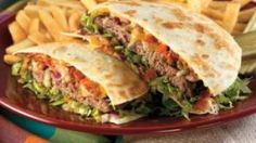 """Quesadilla Hamburger  Cilantro Mayo  1 cupMayo  1 TBSPLime juice  1 TBSPHoney  1 TBSPWorcestershire Sause  1 cloveGarlic; mince  1/4 TSPCumin  1 pinchSalt  1 pinchBlack pepper  2 tbspCilantro; chopped   1 Chipotle Pepper; minced   Additional  6"""" diameter Flour Tortillas  Lettuce; shredded   Cheddar Cheese; Slices   Pepper Jack Cheese; Slices   Bacon; Cooked and Crumbled"""