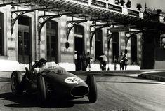 Peter Collins hurling his Ferrari around the Station turn