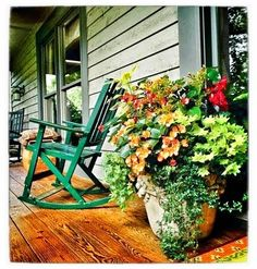 Can't go wrong with a wash tub of flowers and a rocking chair  100 Container Garden Ideas For Arkansas, Texas, Tennessee and The South, Part 3 Jonesboro | Memphis | South Lawn Care Landscape Jonesboro Garden Flowers Container Gardens Best Flowers For Container Gardens BadAsFlowers Arkansas Garden Annuals