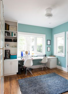 tiffany blue paint in Home Office Transitional with built-in shelves blue wall