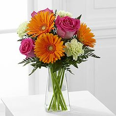 The FTD® Pure Bliss™ Bouquet http://www.touchofloveflorist.com/product/the-ftd-pure-bliss-bouquet-2012-new/display