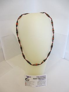Not dressing up for Halloween? Show your Halloween Spirit with this Spooky Gorgeous Black and Orange paper bead necklace made by the Grandmother's of Nyaka! Only $10!