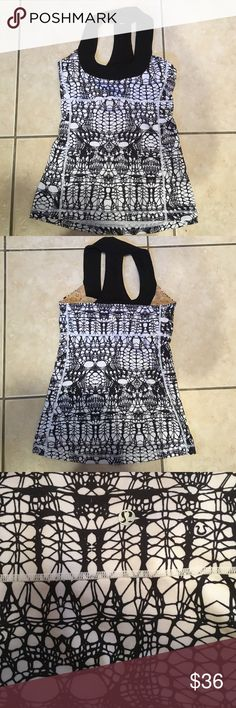 Lululemon sports tank 🎉SALE🎉 Fun black & White designed LuLulemon workout tank. Built in sports bra with great support! Worn twice, great condition!🎉DON'T FORGET TO BUNDLE! EXTRA SAVINGS THIS MONTH ON BUNDLE DEAL!🎉 lululemon athletica Tops Tank Tops