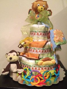 Items similar to Jungle / Safari Diaper Cake on Etsy Baby Shower Diapers, Baby Shower Cakes, Baby Boy Shower, Baby Shower Gifts, Baby Gifts, Baby Showers, Jungle Diaper Cakes, Nappy Cakes, Baby Corsage