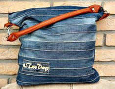 """Sewthis unique denim bag from arecycledpair of jeans. This ebook will walkyou through eachstep of this sewing project. The """"Chobe"""" bag is an ideal size for everyday use. The striped patchwork pattern on the front allows spacefor your own creativity. The bottom of the bag can be made from leather or a"""