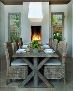 Looking for Living Space and Dining Room ideas? Browse Living Space and Dining Room images for decor, layout, furniture, and storage inspiration from HGTV. Wicker Dining Room Chairs, Wooden Dining Tables, Dining Room Table, Dining Rooms, Outdoor Dining, Trestle Table, Wicker Furniture, Dining Room Fireplace, Dining Room Design