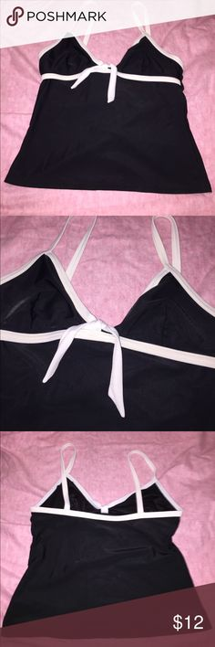 Tankini top Cute and simple tankini top is missing padding, does have the slit for inserts. Size 10 Swim Bikinis