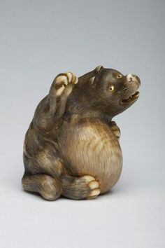 Asian Art Museum. Tenugui (raccoon dog) pounding his belly. Japan, Osaka Masatami (Japanese, active mid-1800s) Date: approx. 1870-1890 Ivory with detail staining; inlaid mother-of-pearl and horn