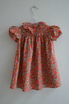 Classic little girl's dresses, in soft colors