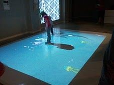 Interactive floor game at GeekSpark -- you feed the fishes by walking on the screen.
