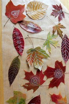 Have you tried drawing on leaves? Making leaf art is one of our family's favorite Autumn activities and we especially love to draw and doodle on pressed Autumn leaves.