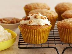 These moist, tender muffins brim with the essence of nutmeg, cinnamon and mashed banana! Honey-infused frosting and a sprinkling of walnuts only sweeten the deal.