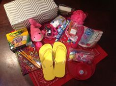 10-14 Girl Box: Zipper cosmetic bag with soap and ziplock bag, scrubby, deodorant, toothbrush, toothpaste, comb, ten hair clips, magic towel washcloth, tissues, manicure set, nail file, band aids. Flip-flops, bandanna and beaded bracelet. Plate, bowl and snack sized ziplock bag with candy. Crayons, notebook, three pencils with erasers, pencil sharpener, sewing kit with plastic beads added, super ball and stuffed dolphin. 2014