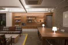 Image 1 of 22 from gallery of Mr. Homes / design studio INTU:NE. Photograph by Hyung-suk Kang Visual Merchandising, Agency Office, Communal Table, Korean Design, Real Estate Agency, Real Estate Houses, Design Furniture, Office Interiors, Retail Design