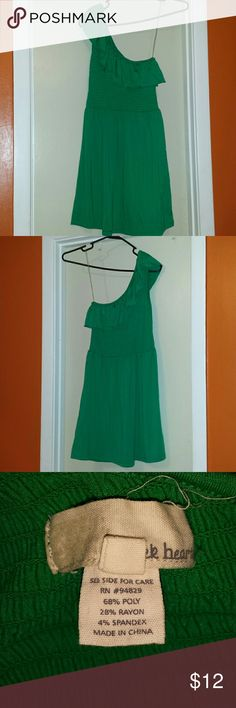 Green One Shoulder Dress This beautiful dress is VERY stretchy in the bust area. This dress is a medium, but I'm usually a large and I can fit it because of how much it STRETCHES! & it snaps right back into its original shape. Perfect for the summer because of its color! The green is so pretty. This dress stops above the knee and is fitted at the top and the rest flows. Derek Heart Dresses One Shoulder