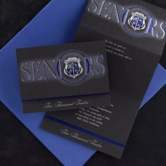 """2012 Black and Royal Blue Deluxe Announcement   Use this announcement to let your friends and family know you're graduating! Announcement copy is available in flat printed, silver or white ink only. Black vellum announcement includes front panel design (in silver and royal), crest, stripe, and horizontal yearline only as shown, and blank inner and outer white envelopes.   Folded announcement size: 6"""" X 4 1/2"""""""