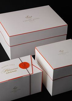 Gorgeous packaging! The white and gold are very classic but the red lining makes the design more unique and eye catching.