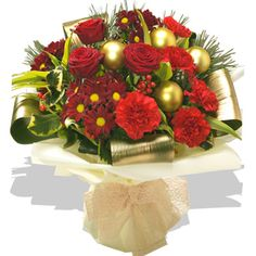 Vintage Bouquet - flowers A sumptuous Christmas Aqua Pack Bouquet featuring velvety red Roses, ruby red Carnations and deep red spray Carnations. A flourish of variegated Holly and sprinkling of golden baubles complete the des http://www.comparestoreprices.co.uk/flowers-and-flower-delivery/vintage-bouquet--flowers.asp