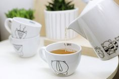 Large, white originally designed and hand-painted mug for tea or coffee. PATTERN: LET'S MOVE MOUNTAINS  Decorate your kitchen and get creative with the kitchen accosseries. FOR.REST equals minimalistic design for your interiors. White porcelain is a perfect element for your kitchen. Funny, hand-pain...