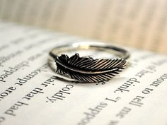 """leaf ring, so cute *-*"" <- that's a feather, you idiot."