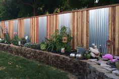 Beautiful wood and metal fence hides cinder block fence