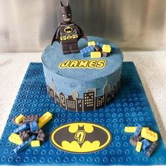 Lego Batman cake for James! Chocolate cake, Oreo buttercream filling and Swiss meringue buttercream. Edible images were used for the Batman logo and name. Fondant accent Lego blocks and figurine.