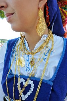 Gold necklace and traditional gold earrings. Our Lady of Agony Festivities, the biggest traditional festival in Portugal. Viana do Castelo.