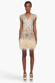 Matthew Williamson Cap sleeve lace dress in gold tone and beige. Sequin fabric with   cylindrical beads and rhinestones. Feather hem detail. 6,525.00