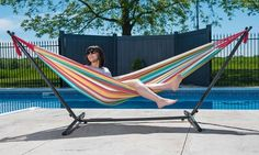 Double-sized hammock big enough for two swings from a sturdy metal stand