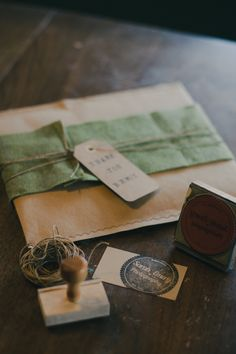 photography packaging earthy rustic colors rubber stamped logo and twine.