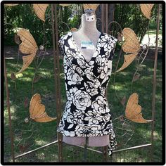 Sleeveless Top This top is sleeveless with wrap to left side with tie. Vneck front and back. Black & white. Speechless Tops Blouses