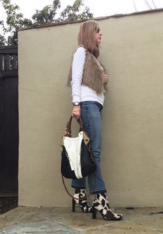 Giddy Up, Cowgirl, cowhide print calf hair boots, KUT jeans, Salt necklace, faux fur vest, style over forty, fashion over forty, best style bloggers over forty, midlife style, middle aged fashion, fun with fashion over forty, cowgirl inspired look over forty, trendy over forty